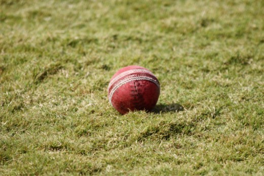 A cricket ball on the ground : Stock Photo