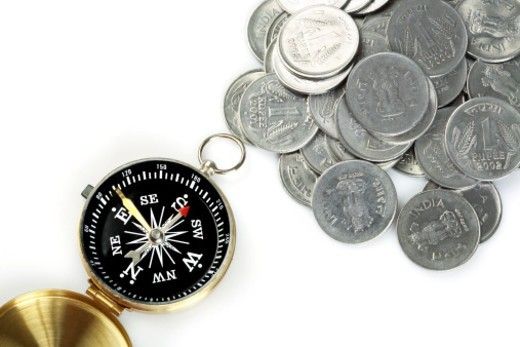 Stock Photo: 1491R-1184724 Close up of compass and one rupee coins