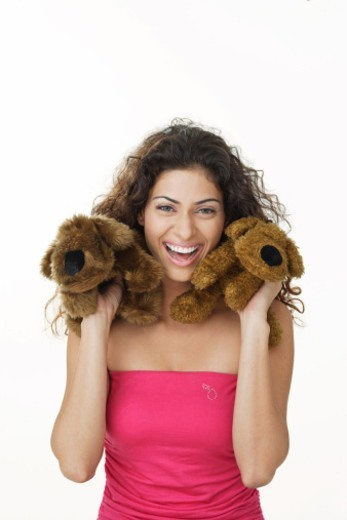 Stock Photo: 1491R-1184815 Young woman holding soft toys. Modeling