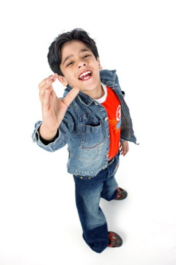 Portrait of a boy doing a hand gesture : Stock Photo