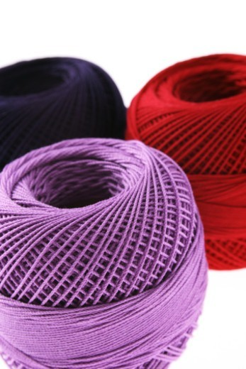 Stock Photo: 1491R-1185208 Partial view of spools of thread