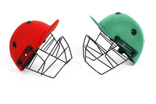 Stock Photo: 1491R-1185341 Two cricket helmets facing each other, studio shot