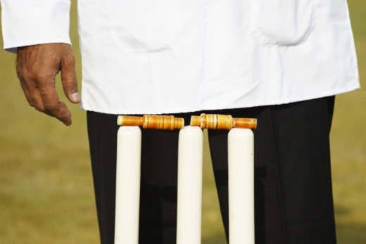 Stock Photo: 1491R-1185344 Umpire standing behind the stumps