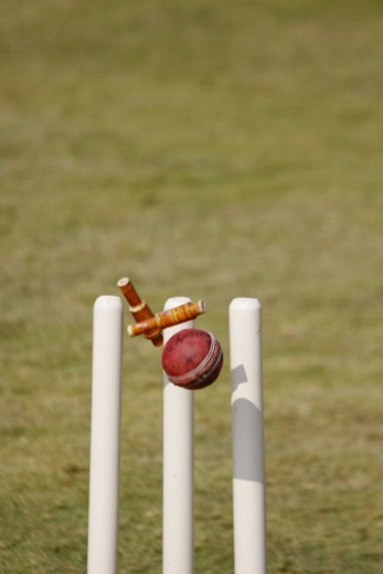 Stock Photo: 1491R-1185350 Close of a ball hitting the stumps