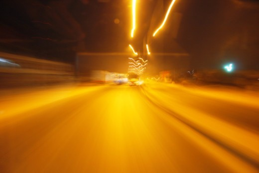 Stock Photo: 1491R-1185450 Distorted image of traffic at night