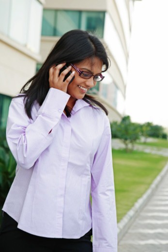 Businesswoman speaking on mobile phone : Stock Photo