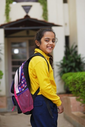 Stock Photo: 1491R-1185812 A girl dressed in school uniform