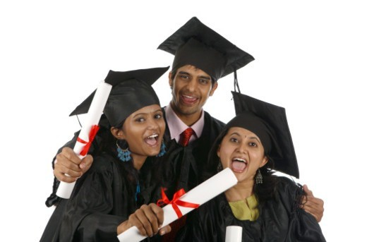 Graduates screaming out of excitement, holding diploma : Stock Photo