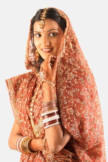 Portrait of an Indian bride shying away : Stock Photo