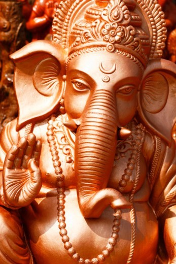 Stock Photo: 1491R-1186218 Close up of a painted sculpture of Lord ganesh