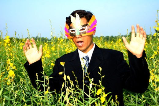 A masked man in a field : Stock Photo