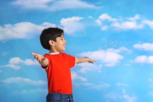 Stock Photo: 1491R-1186730 Boy playing with soap bubbles