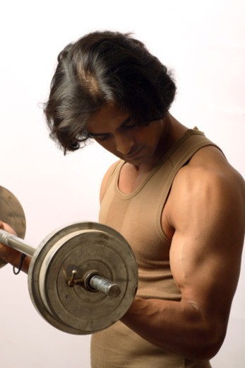 A young man exercising : Stock Photo