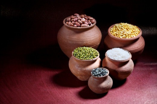 Stock Photo: 1491R-1187666 Rice, nuts and pulses in earthen pots