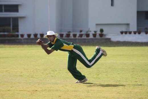 Stock Photo: 1491R-1187781 A fielder attempting to catch the ball