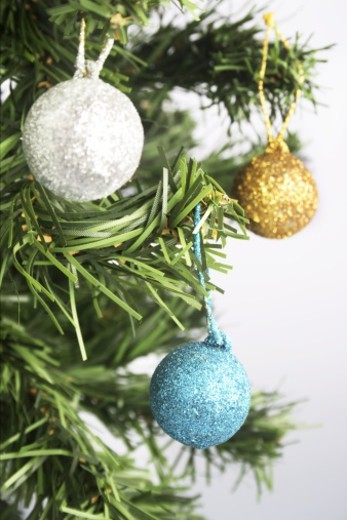Close up of a Christmas tree with baubles : Stock Photo