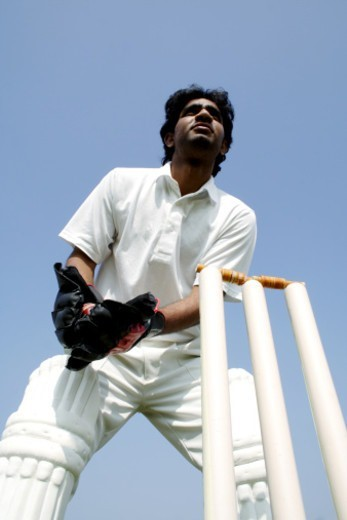 Stock Photo: 1491R-1187918 Wicket keeper catching the ball