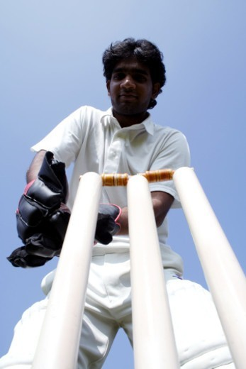Stock Photo: 1491R-1187919 Wicket keeper catching the ball