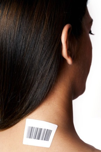Rear view of a woman with a barcode on her neck : Stock Photo