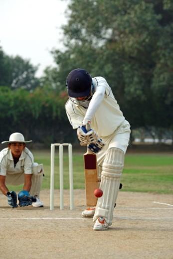 Batsman defending a ball : Stock Photo