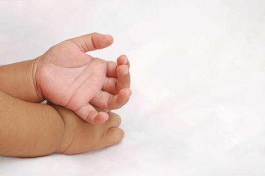 Stock Photo: 1491R-1188796 Partial view of a baby's hands