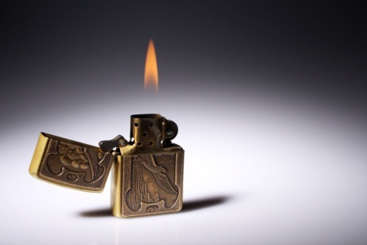 Stock Photo: 1491R-1189557 A Lighter burning