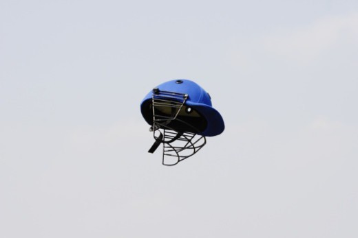 Stock Photo: 1491R-1189672 A blue colour helmet in the air