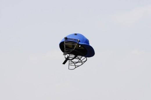 A blue colour helmet in the air : Stock Photo