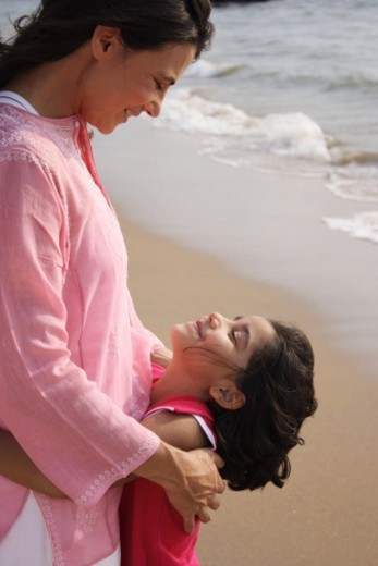 A mother enjoying the beach with her daughter : Stock Photo