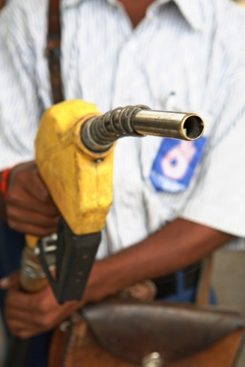 Stock Photo: 1491R-1191140 Person holding a petrol pump