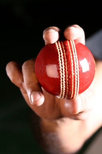 Stock Photo: 1491R-1191220 Person holding a Cricket ball