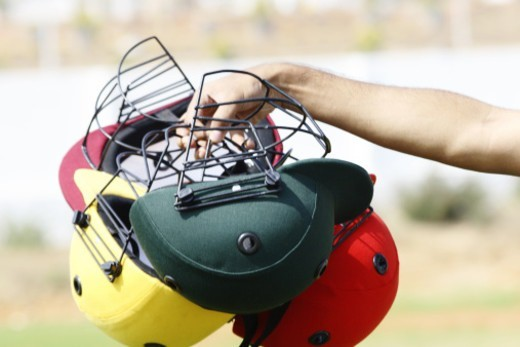 Stock Photo: 1491R-1191456 A person holding cricket helmets