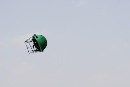 Stock Photo: 1491R-1191457 A green colour helmet in the air