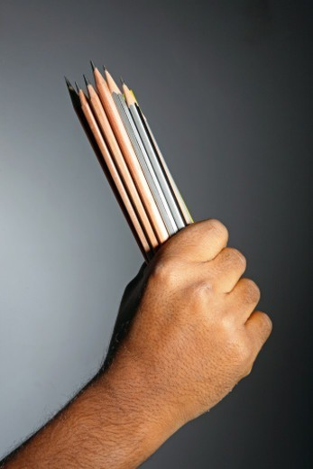 Man holding buch of pencils : Stock Photo