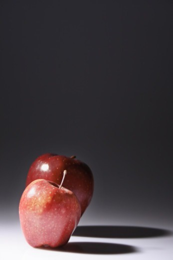 Stock Photo: 1491R-1192198 Two apples of varying sizes