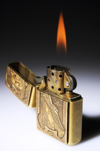 Stock Photo: 1491R-1192211 A Lighter burning