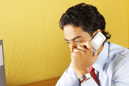 A business man talking on cell phone : Stock Photo