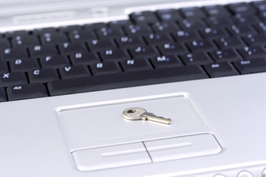 Close up shot of a key on top of a laptop : Stock Photo