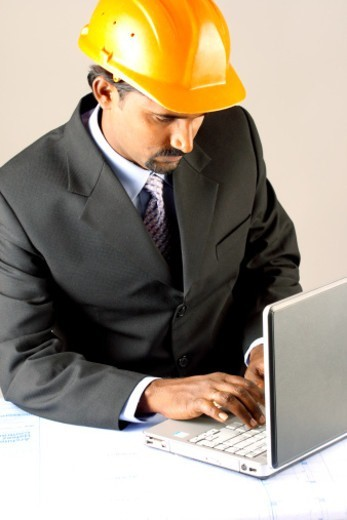 Portrait of an architect working on a plan : Stock Photo