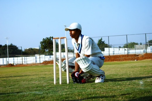 Stock Photo: 1491R-1194088 Wicket keeper behind the stumps