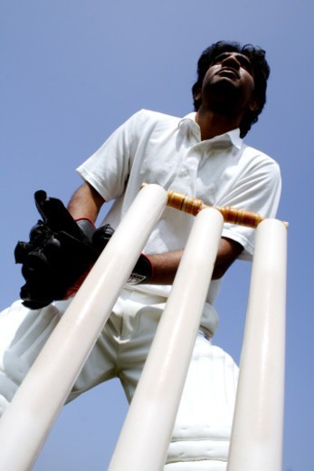 Wicket keeper catching the ball : Stock Photo