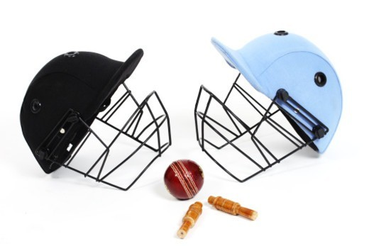 Stock Photo: 1491R-1194108 Two cricket helmets facing each other , studio shot