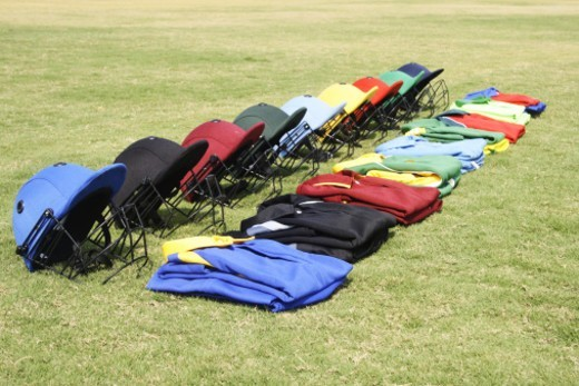 Stock Photo: 1491R-1195007 Cricket helmets and jerseys on the ground
