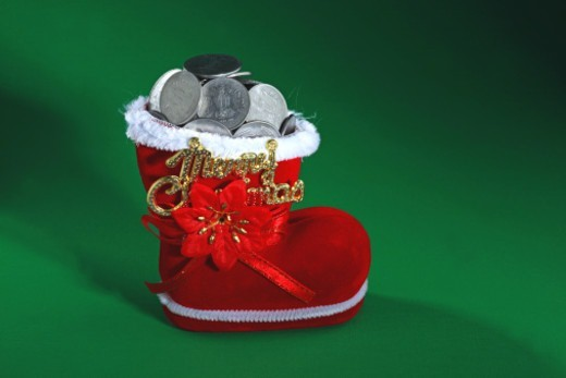 Stock Photo: 1491R-1195363 Close up of Santa shoes full of coins