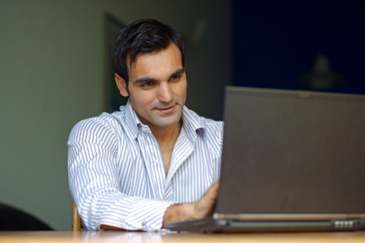 Young man working on a laptop : Stock Photo