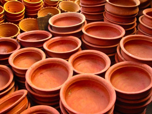 Red clay Pottery placed in line for sale : Stock Photo