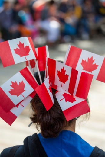 Young woman with Canadian flags in hair, Canada Day, Granville Island, Vancouver, BC, Canada : Stock Photo
