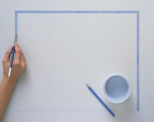 Painting a rectangle outline by following a blue pencil outline : Stock Photo