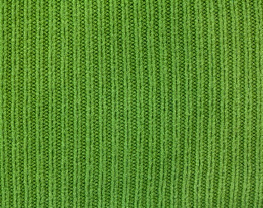 Stock Photo: 1491R-1198880 Green piece of fabric shot macro. The photograph is full frame and can be used as background. Studio shot, horizontal frame.