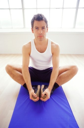 a young man exercising on a exercise mat : Stock Photo